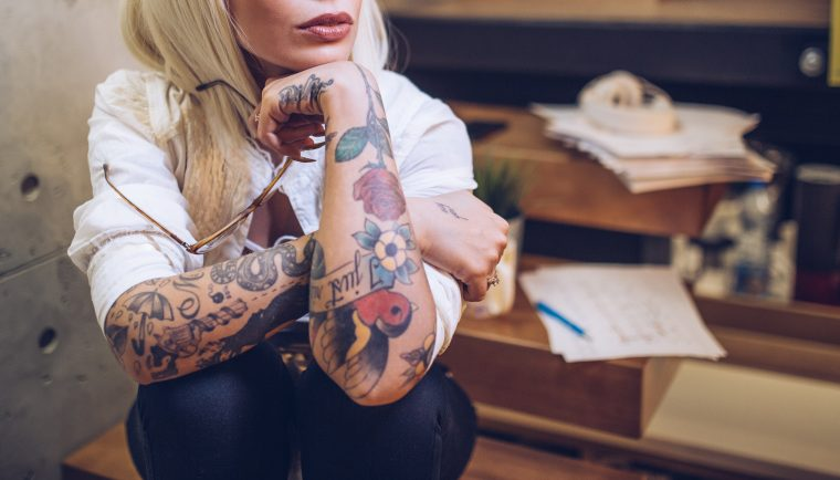 tattooed woman working 1 760x434 - Things to Know About People With Tattoos