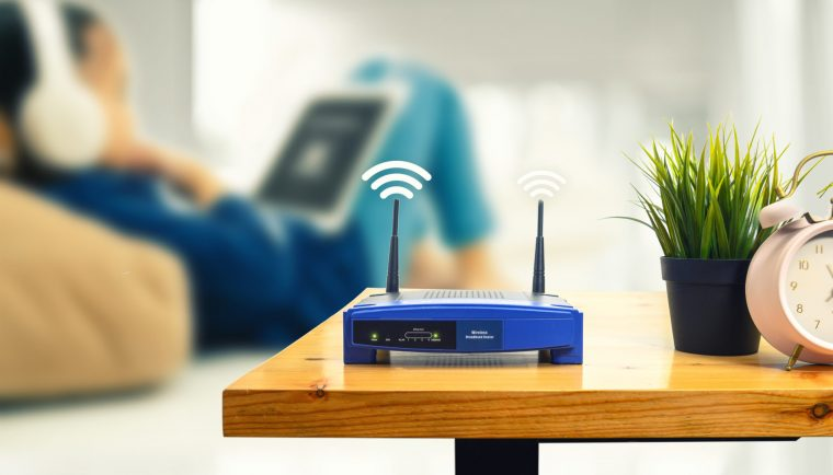closeup wireless router man using smartphone living room home office scaled 1 760x434 - What is broadband and which broadband is better?