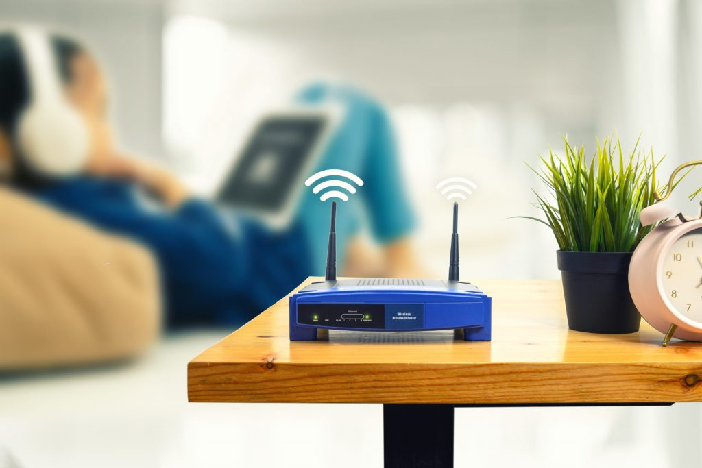 closeup wireless router man using smartphone living room home office scaled 4 1024x683 - What is broadband and which broadband is better?